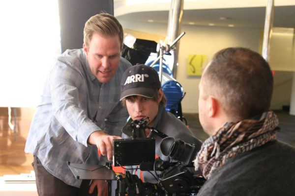 Mark Baas directing with crew